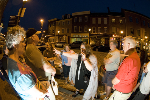 Baltimore Ghost Tours guide Leanna leads a group in Fells Point